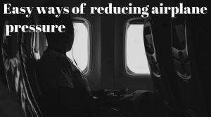 using earplugs or headphones to reduce the airplane pressure
