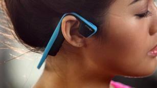 wearing Aftershokz headsets