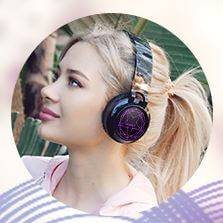 Teenage girl wearing Riwbox WT-8S Bluetooth Headphones.
